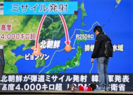 A man watches TV news program reporting North Korea's missile launch, in Tokyo. Nov. 27