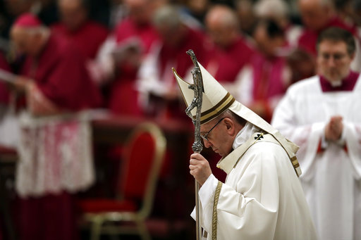 Pope Francis holds his pastoral staff as he celebrates the Christmas Eve Mass in St. Peter's Basilica at the Vatican, Sunday, Dec. 24, 2017. (AP Photo...