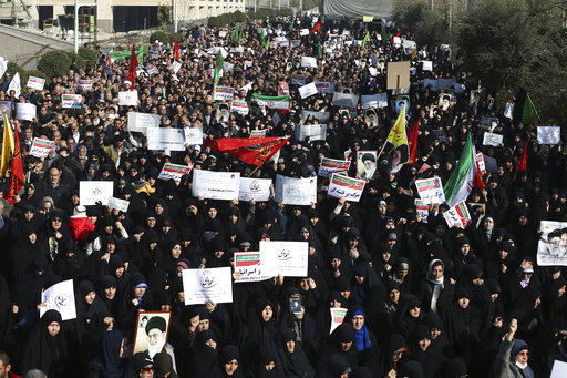 Iran hard-liners rally in response to protests challenging the Iranian government