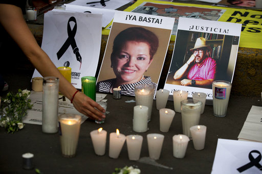 Pictures of murdered journalists Miroslava Breach, left, and Javier Valdez, right, in Mexico City.