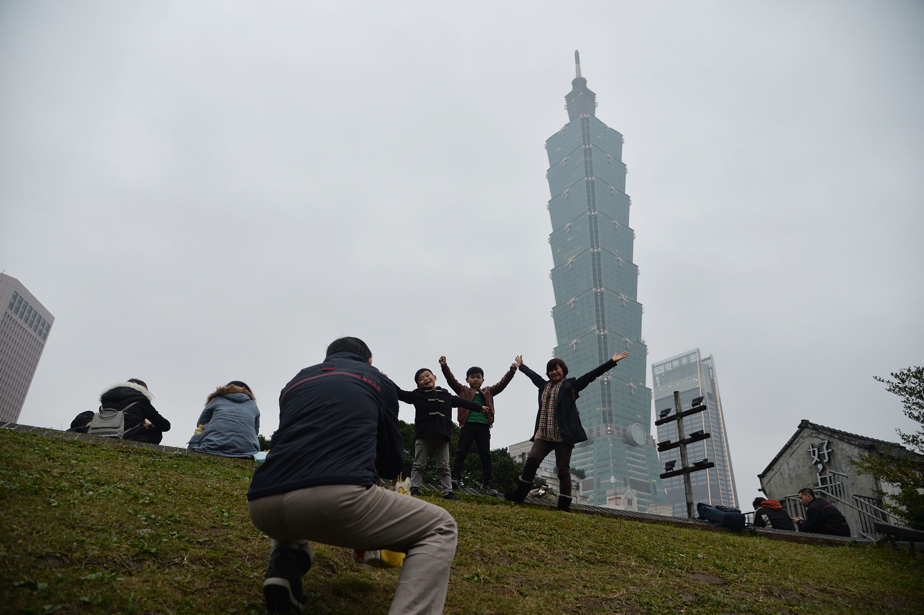 Crowds gathered in Taipei's eastern district early to view the New Year's Eve fireworks.