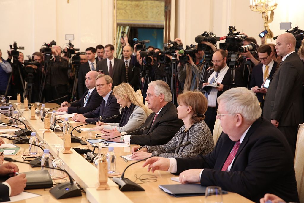 Senior policy adviser Brian Hook (at table, second from left) with Secretary of State Rex Tillerson (third from right). (photo Department of State)