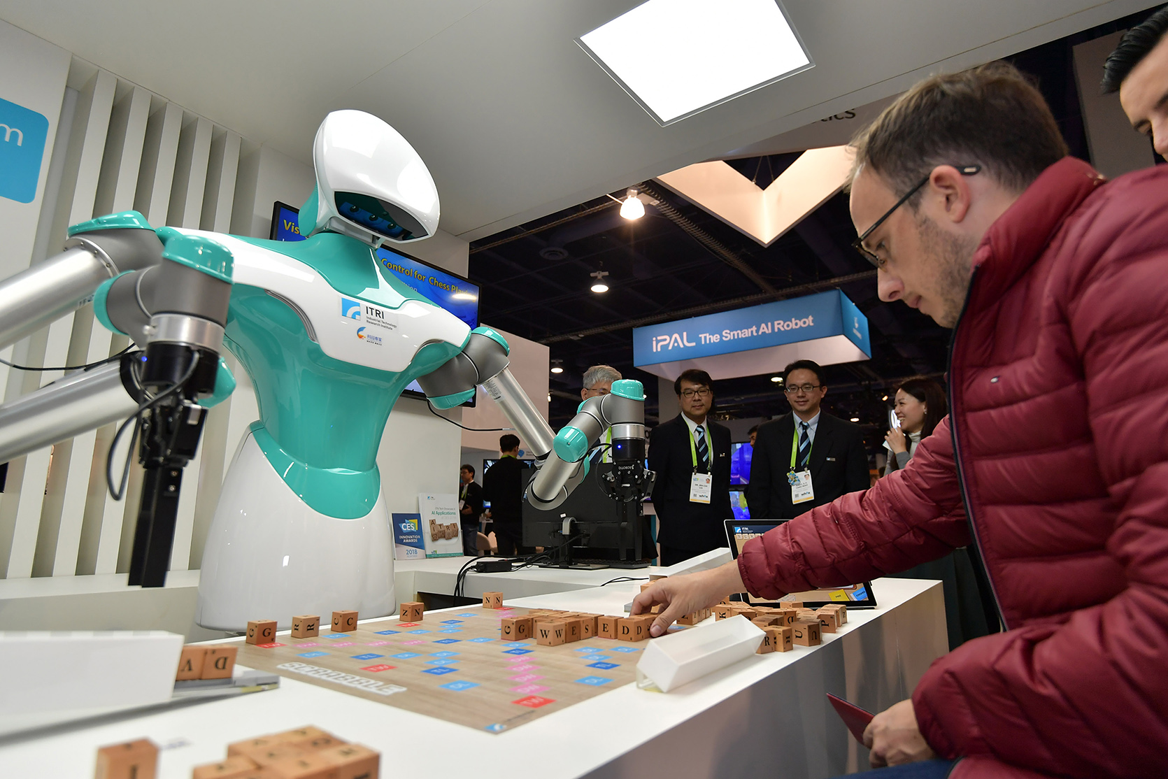 ITRI's IVS robot has attracted numerous CES visitors to play Scrabble during the CES show. (Credit: ITRI)