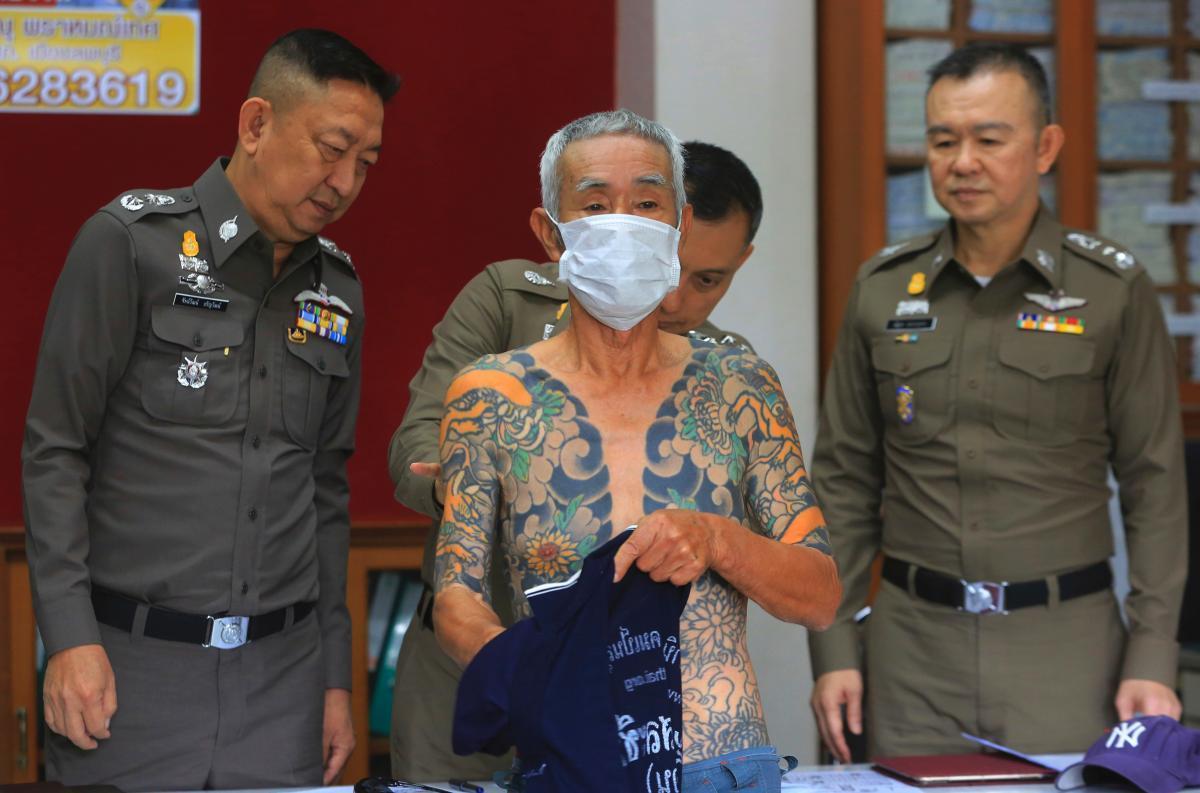Thai police escortingShirai