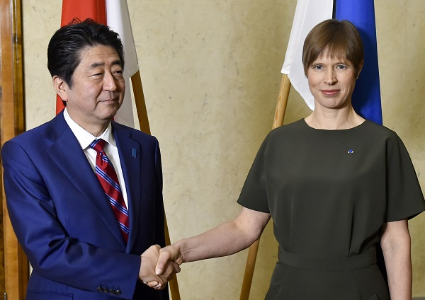 Japanese Prime Minister Shinzo Abe, left, and Estonian President Kersti Kaljulaid shake hands prior to their talks in Tallinn, Estonia, Friday, Jan. 1