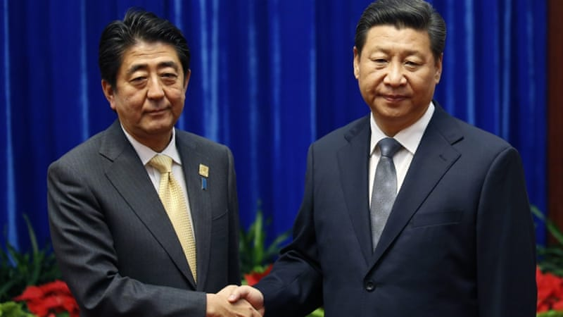 Xi Jinping meets Shinzo Abe at APEC summit Dec. 2014