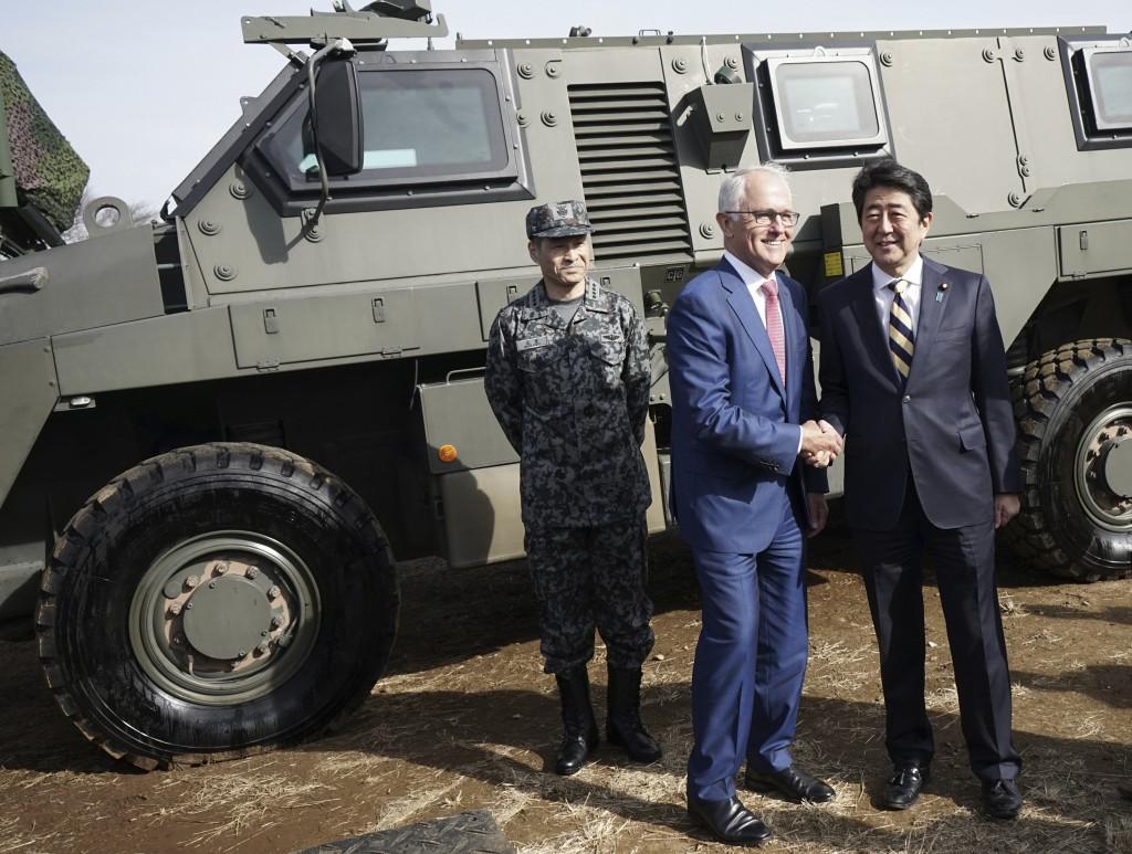 今日澳洲總理滕博爾旋風式訪問東京一天,與日本首相安倍晉三會面。 (美聯社)