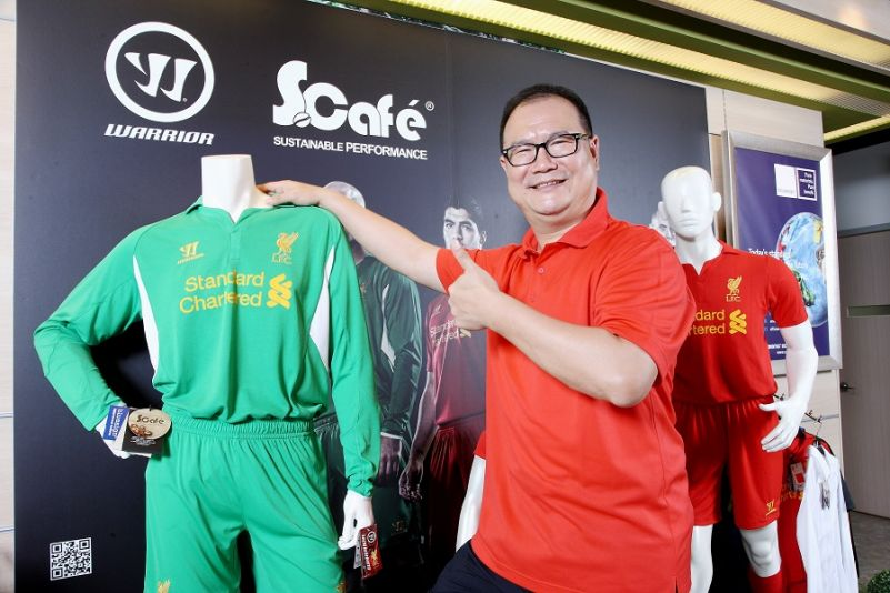 Singtex Industrial Co. Ltd. founder Jason Chen gives the thumbs-up to his company's S.Cafe fabrics used in the manufacture of performance apparel for ...