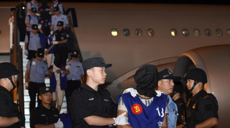 Taiwanese suspects deported from Cambodia to China in 2016.