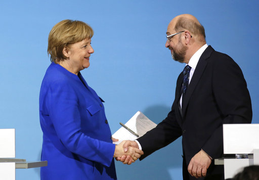 German Chancellor Angela Merkel, shakes hand with Social Democratic Party Chairman Martin Schulz