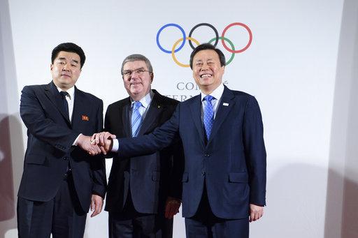 南北韓代表在奧運委員會(圖片來源:美聯社)