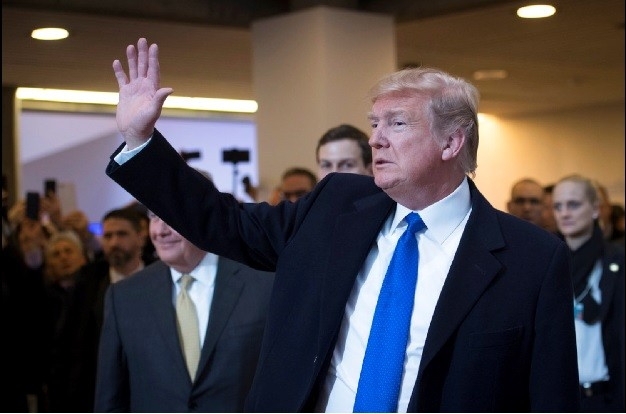 圖為川普25日在瑞士出席世界經濟論壇(WEF)會議。美聯社