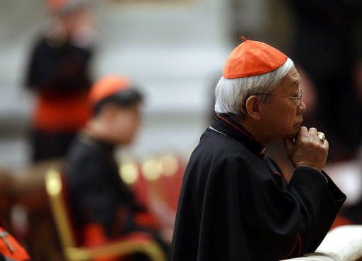 Cardinal Joseph Zen prays in St. Peter's Basilica.