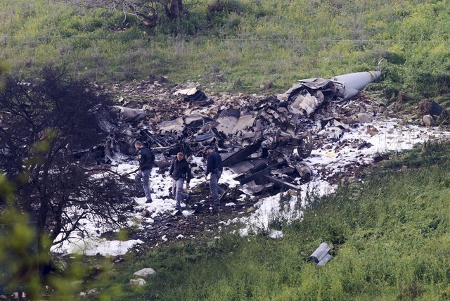Israeli security stands around the wreckage of a downed Israeli F-16.