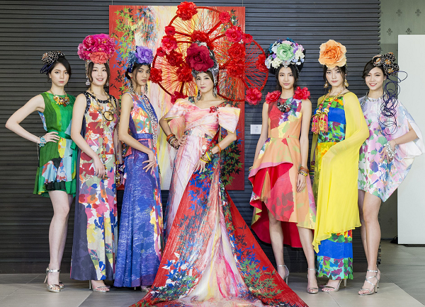 Models wearing gowns with prints by Zhong Youhui, designed by Lin Guoji, at the Zhong's Manyoshu exhibition, Feb. 9.