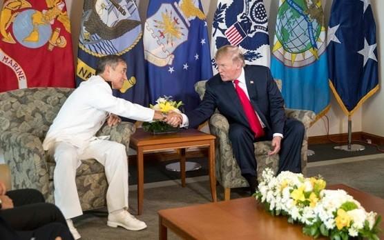 File Photo: Pres. Trump and Adm. Harris shaking hands, Nov. 2017