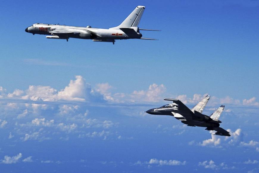 File Photo: Chinese H-6K Bomber and Su-30 Fighter Jet (taken September, 2016)