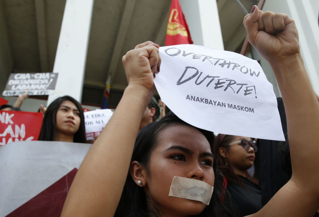 """Students from Univ. of the Philippines walk out of classes to call for an """"end to President Rodrigo Duterte's rising dictatorship"""" Friday, Feb. 23."""