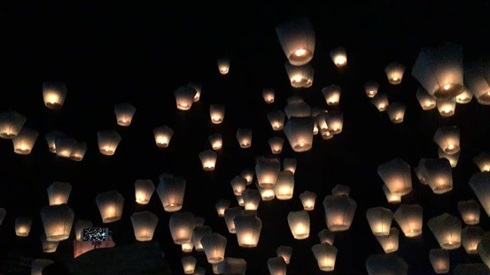 Pingxi Sky Lanterns aloft in the night sky.