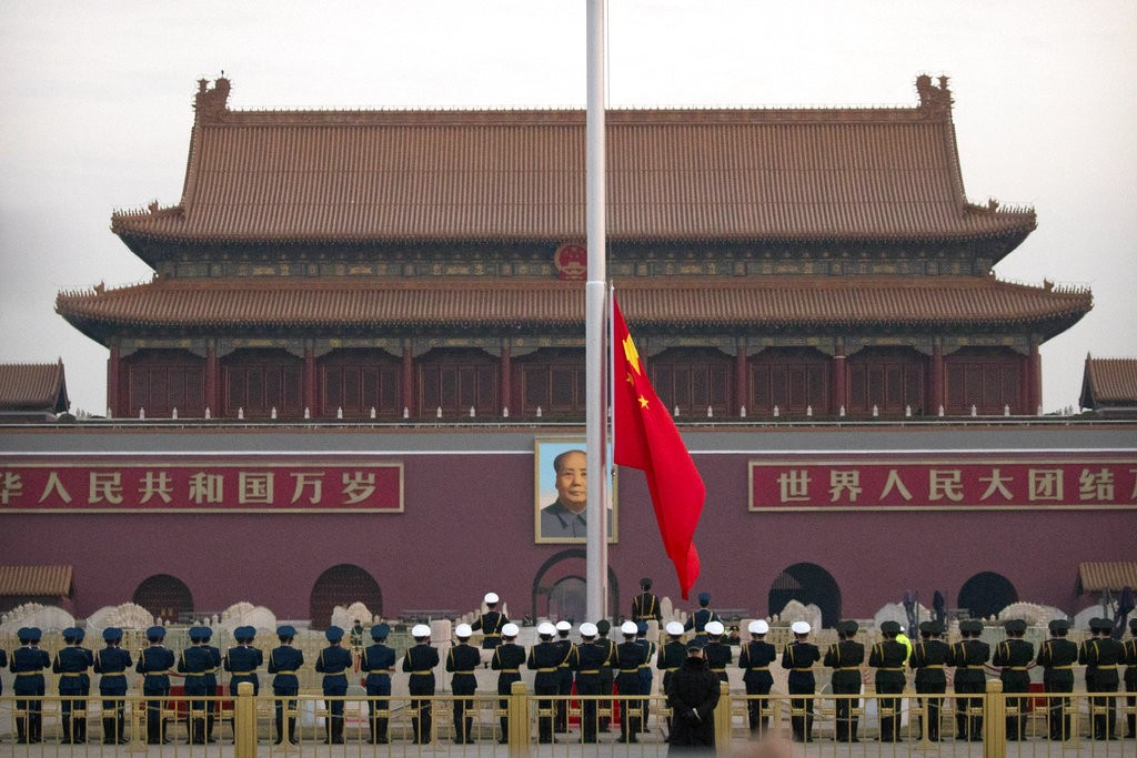 A Chinese honor guard raises the flag at dawn on Tiananmen Square ahead of the opening session of China's National People's Congress (NPC) at the near...