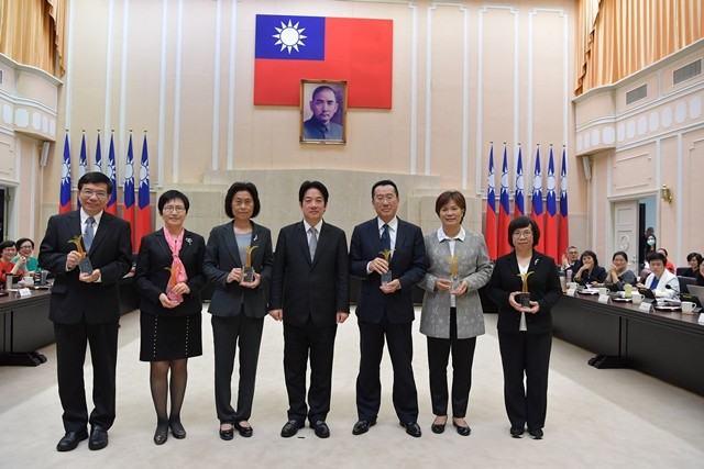 Premier Lai Ching-te (center) is joined by senior officials from central government agencies honored for promoting gender equality March 5 in Taipei C