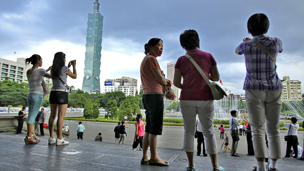Tourists at the Sun Yat-sen Memorial Hall in Taipei.