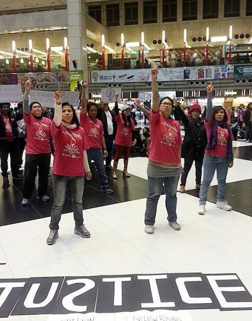 Migrant workers dancing at the Taipei Railway Station.