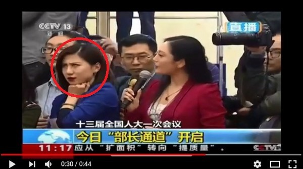 Reporter on left rolls her eyes