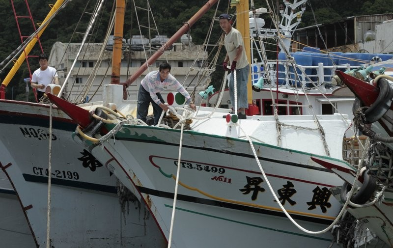 File photo: Workers on board a Taiwanese  flagged fishing vessel, Oct. 2013