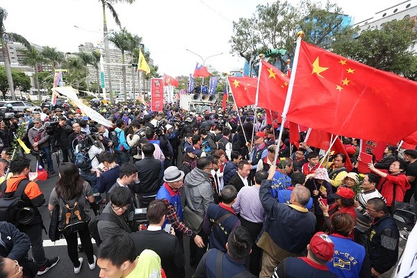 Pro-China Unionist Party members flew flags of China at a demonstration against military pension reform