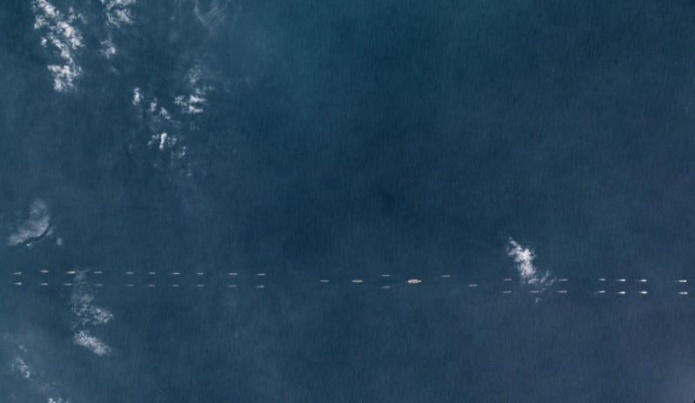The Liaoning carrier (center) amid a procession of 40 plus PLAN vessels in the South China Sea (Image via Planet Labs)