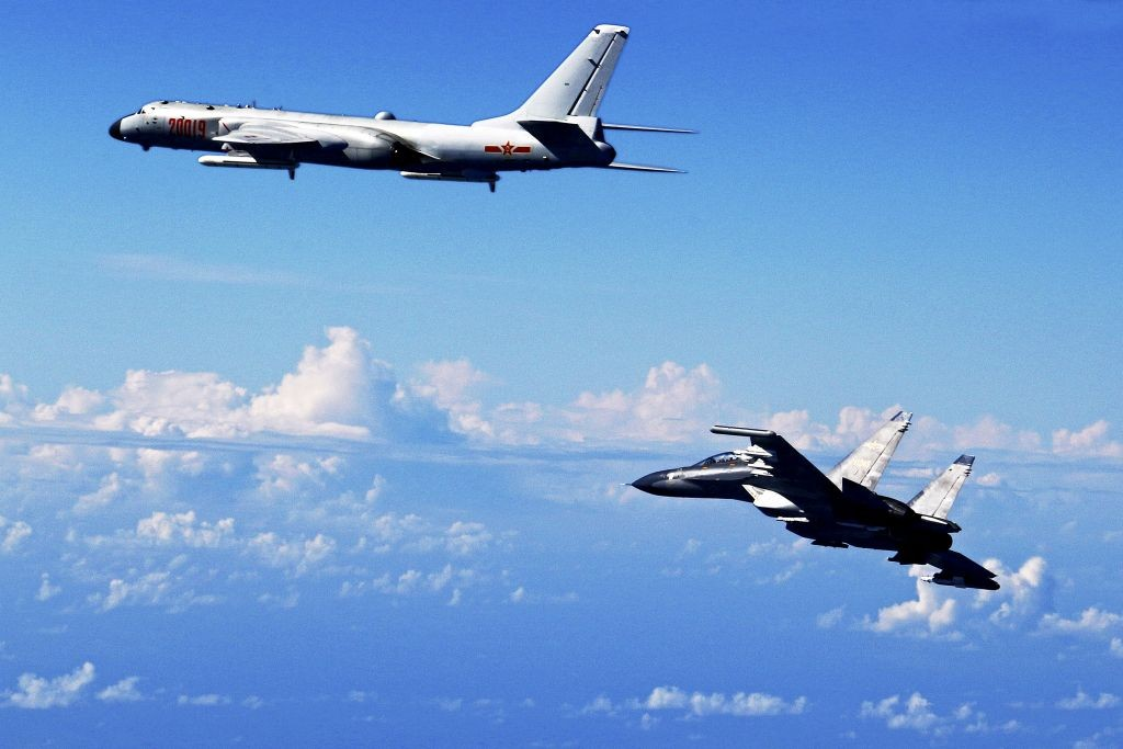 A Chinese H-6K bomber (left) and a Su-30 fighter jet.