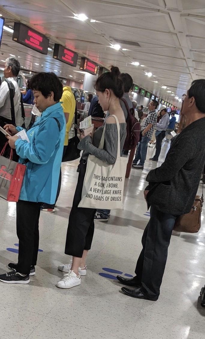 Taiwanese woman seen at airport carrying bag saying it has 'gun, bomb' inside