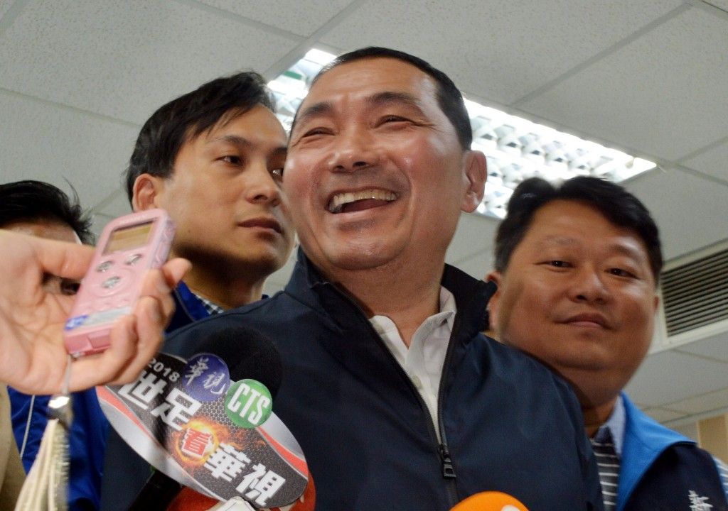 Former national police chief Hou Yu-ih (center) celebrates victory in KMT primaries for New Taipei City mayor.
