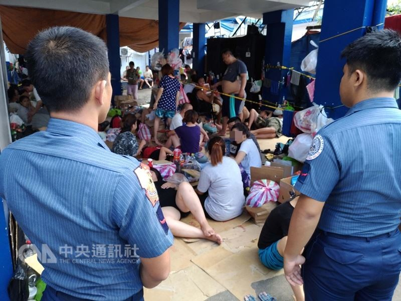 Fraud suspects being held by police in the Philippines last February.
