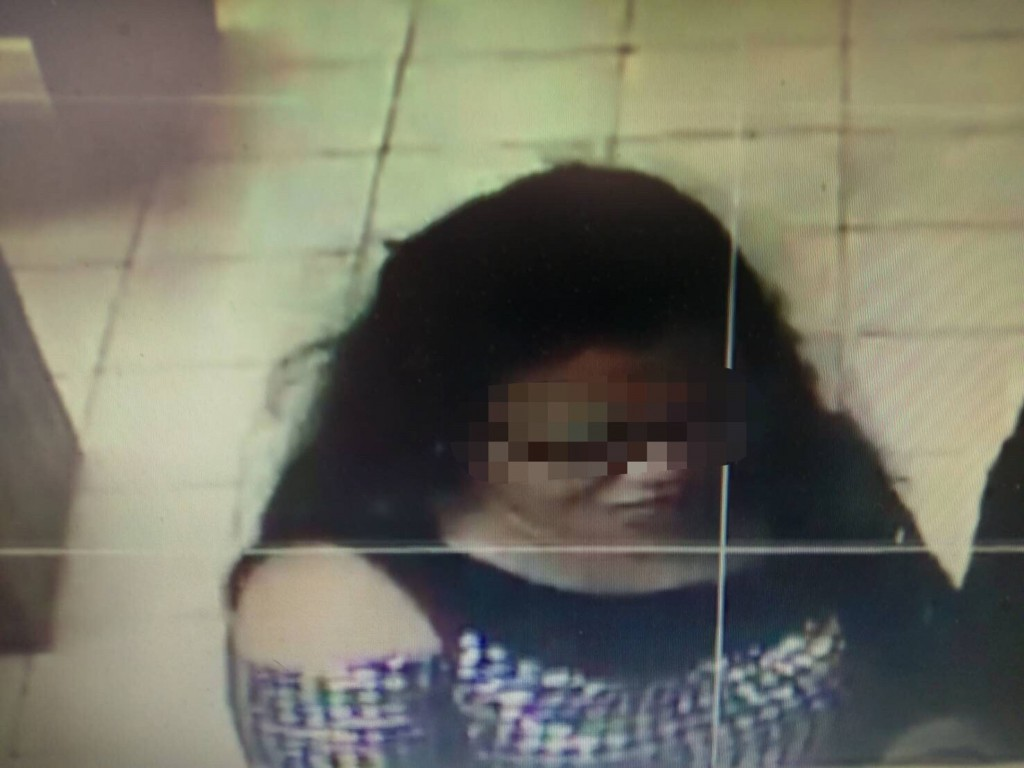 Filipino woman arrested on suspicion of working for fraud ring.