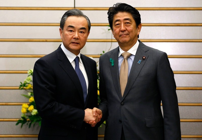 Chinese Foreign Minister Wang Yi, and Japanese Prime Minister Shinzo Abe, Monday, April 16