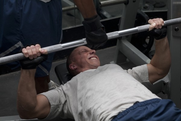 Stock image of man bench pressing. (US Air Force Central Command)