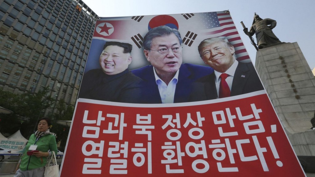 A banner showing the North Korean leader, South Korean President Moon and President Trump erected in Seoul to support the summit between the two Korea...