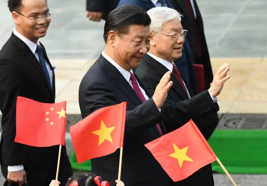 Xi Jinping, and Vietnam Communist Party General Secretary Nguyen Phu Trong, right, in Hanoi, Vietnam Sunday, Nov. 12, 2017