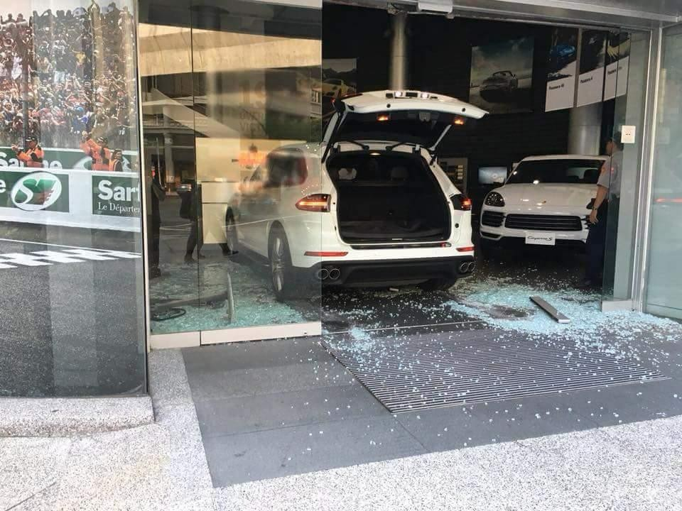 Video shows Taiwanese man crash Porsche into dealership after not getting optional extras