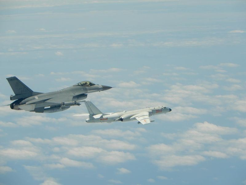 A Taiwanese F-16 (left) keeps a close eye on a Chinese H-6K (right) near Taiwan Friday.