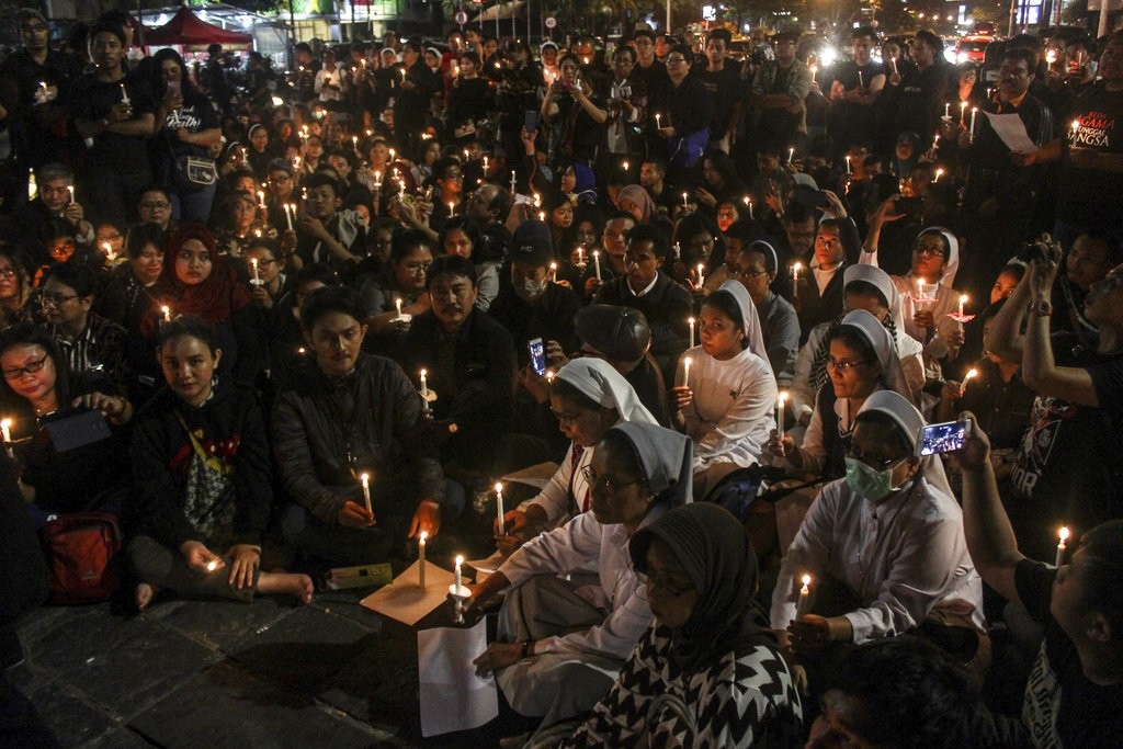 Indonesia church attacks: family of bombers 'had been to Syria'
