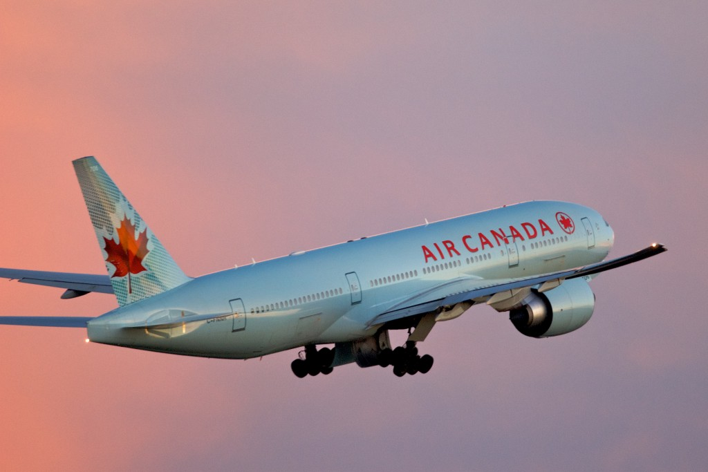 The photo shows Air Canada Boeing 777-200LR Toronto takeoff