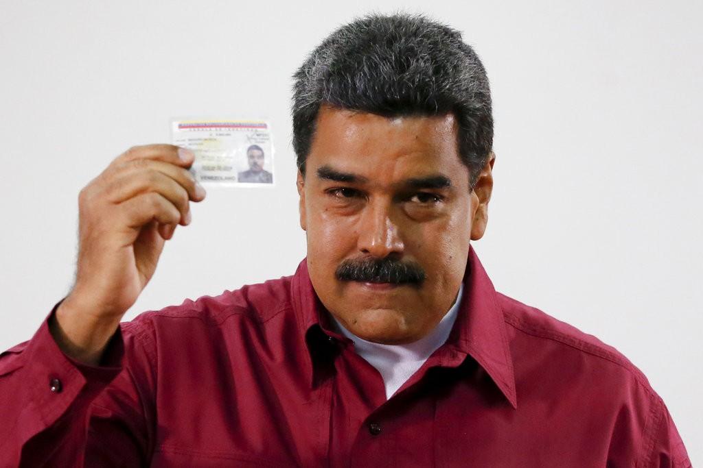 馬杜洛持身份證前往投票(美聯社)