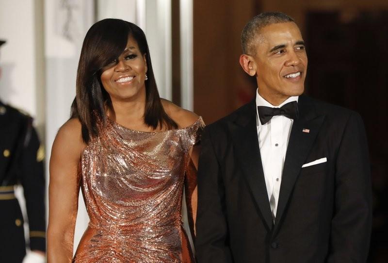 美國前總統歐巴馬與前第一夫人蜜雪兒(美聯社)