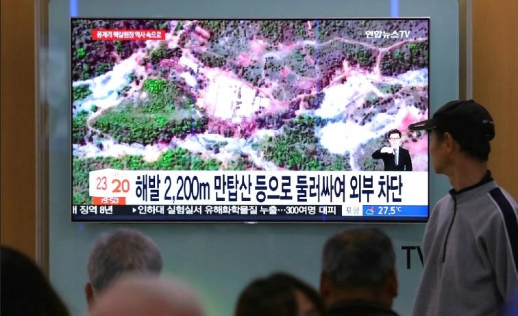 圖為電視台播出北韓核子試驗場的衛星畫面 (美聯社)
