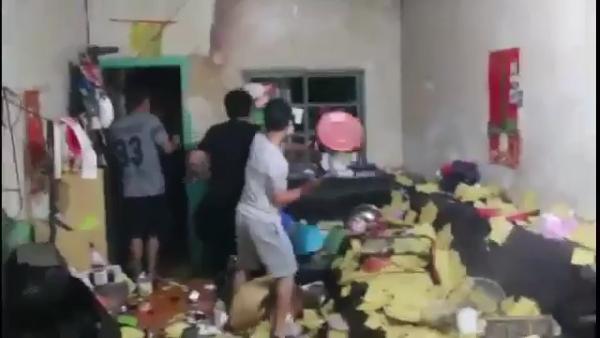 Man smashing window with stool. (Screenshot of YouTube video)