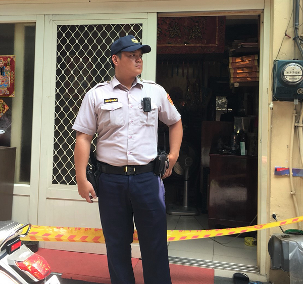 A police officer stands outside the home where the crime occurred in Pingtung, Taiwan