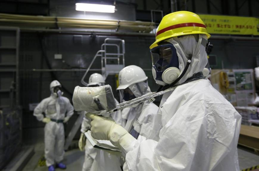 Employees at the Fukushima facility in protective suits